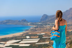 Woman looking over beach on Crete Royalty Free Stock Photography