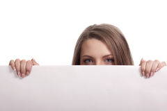 Woman looking over blank card Royalty Free Stock Images