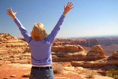 Woman looking over a dramatic vista stock photo