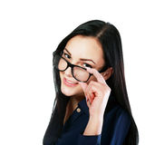 Woman looking over glasses Royalty Free Stock Image