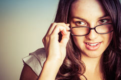 Woman Looking Over Glasses Stock Photography
