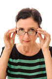 Woman looking over glasses portrait Stock Images