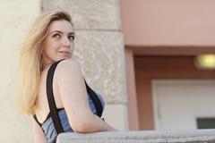 Woman looking over her shoulder Stock Photo