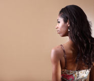 Woman looking over her shoulder Stock Images
