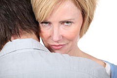 Woman looking over man Royalty Free Stock Photos