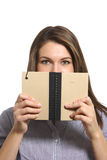 A woman looking over a note book in the studio. A attractive woman looking over an note book in the studio Royalty Free Stock Photography