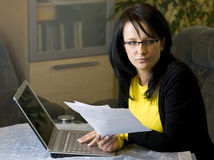 Woman looking over paperwork stock photo