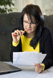 Woman looking over paperwork Royalty Free Stock Photography