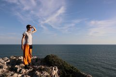 Woman looking over the sea into the distance royalty free stock photo