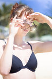 Woman Looking Over Sunglasses Stock Image