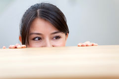 Woman looking over a table Stock Photography