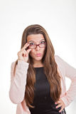 Woman looking over top of glasses Royalty Free Stock Photography