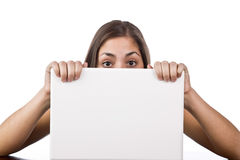 Woman looking over the top of her laptop Stock Photos