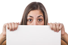 Woman looking over the top of her laptop Royalty Free Stock Image