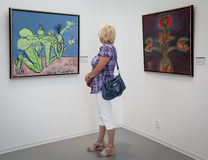 Woman looking at the painting in the gallery Danubiana, Bratisla Royalty Free Stock Images
