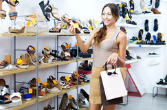 Woman looking after pair of shoes Royalty Free Stock Image