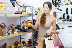Woman looking after pair of shoes Stock Photography