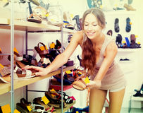 Woman looking after pair of shoes Stock Photo