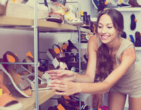 Woman looking after pair of shoes Royalty Free Stock Photo