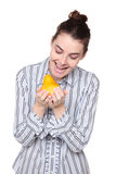 Woman looking at pear hungrily Stock Photos