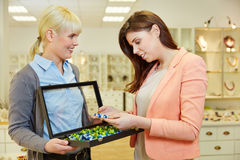 Woman looking for pearls in jewelry Stock Image