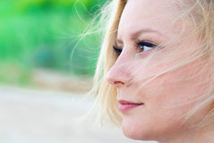 Woman looking pensive. Into the distance Stock Photos