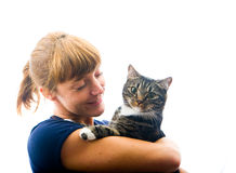 Woman looking at pet cat. Woman looking at her pet cat lovingly royalty free stock images