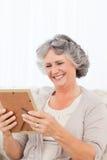 Woman looking at a photo Royalty Free Stock Image