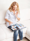 Woman looking photo book Stock Photos