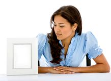 Woman looking at a photo frame Royalty Free Stock Photo