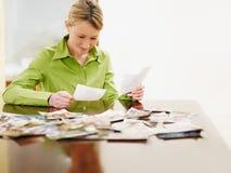 Woman looking at photos royalty free stock photo