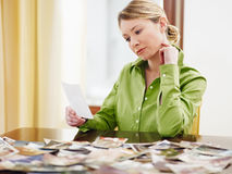 Woman looking at photos Royalty Free Stock Photography