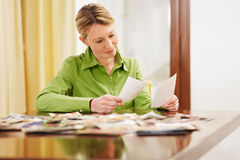 Woman looking at photos royalty free stock image