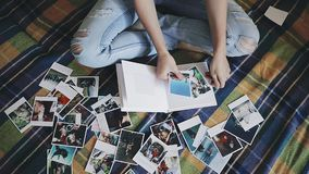 Woman looking at photos and creating an album