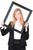 Woman looking through picture frame Stock Photos