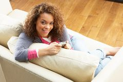 Woman Looking At Pictures On Digital Camera Royalty Free Stock Images