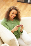 Woman Looking At Pictures On Digital Camera Royalty Free Stock Photo