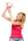 Woman looking at piggy bank Stock Image