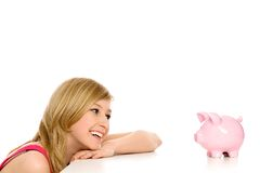 Woman looking at piggy bank Stock Image