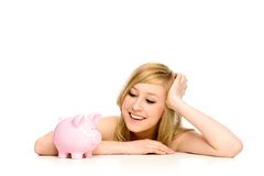 Woman looking at piggy bank Stock Images