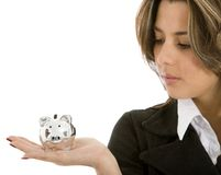 Woman looking at a piggy bank Stock Photography