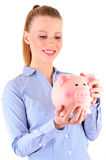 Woman looking at a piggy bank. Young business woman looking at a piggy bank while holding it. Very crisp and fresh picture Stock Images