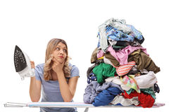 Woman looking at a pile of clothes Royalty Free Stock Image