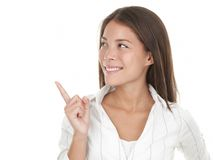 Woman looking and pointing at copy space Stock Photography