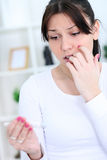 Woman looking at a pregnancy test Royalty Free Stock Photography