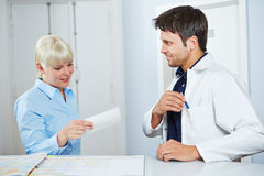 Woman looking at prescription from doctor Stock Image