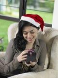 Woman looking at present box Stock Photo