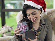 Woman looking at present box Royalty Free Stock Photos