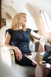 Woman Looking Through Private Jet's Window Royalty Free Stock Photos
