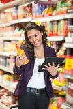 Woman looking at a product Stock Photo